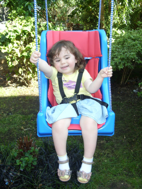 Isabella on her swing